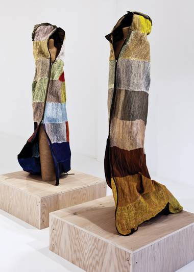 "Cathy Fairbanks' ""Sleeping Bags"" presents two sleeping bags lovingly stitched in swirling methodical zigzags that pucker and manipulate them in such a way as to subtly suggest the curve of a recently vacated body."