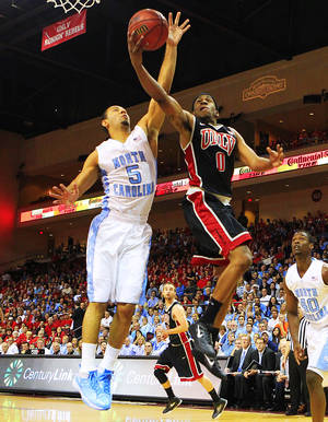 UNLV's Oscar Bellfield is guarded by University of North Carolina's Kendall Marshall during their Las Vegas Invitational championship game Saturday, Nov. 26, 2011 at the Orleans Arena.