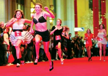 Shoe business: Ladies paid $100 on Saturday night to race across the casino floor at the Palazzo.