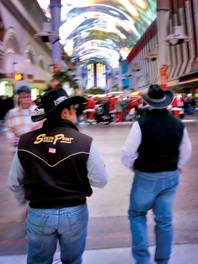 Some cowboys take in the Fremont Street Experience while in town for NFR.