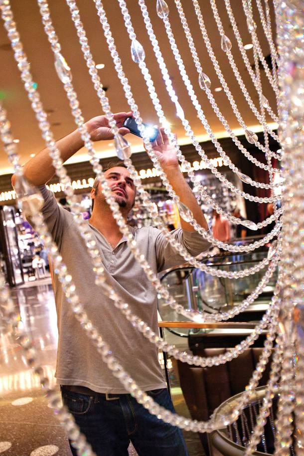 Snapping photos of the Chandelier Bar's canopy of 2 million crystal beads.