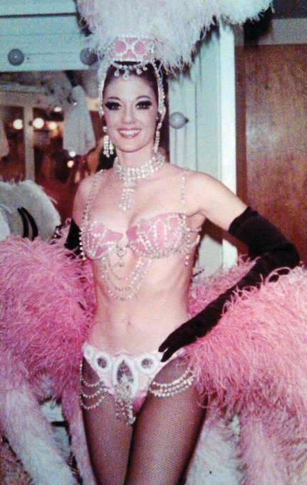 Saxe's mother, Bonnie, in her showgirl costume.