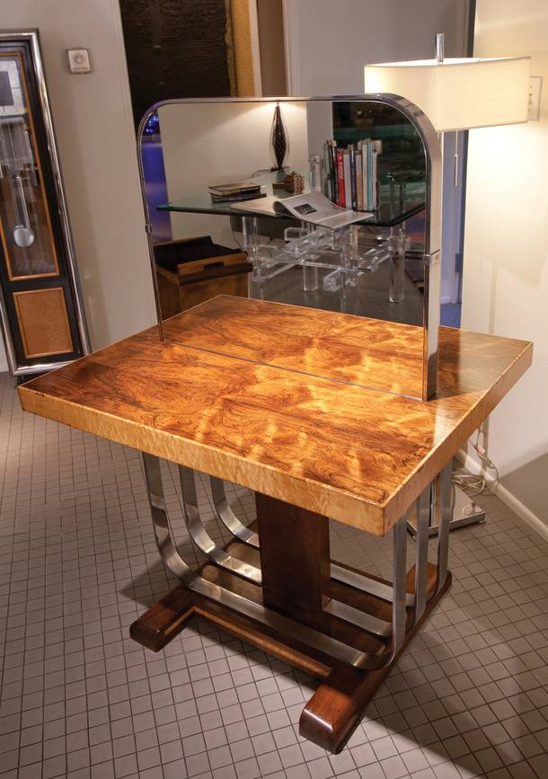 An art deco table once used in a milliner store is in the home of Steve Evans