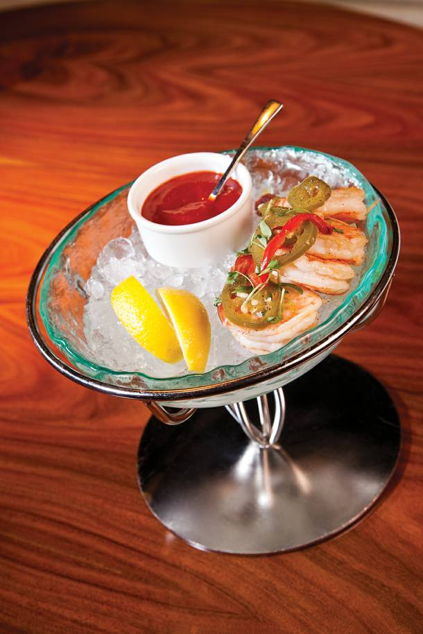 The shrimp cocktail is deliciously askew--lightly pickled and spiced prawns served with a peppy cocktail sauce.