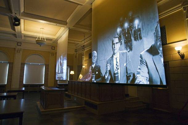 A video presentation is shown in a courtroom during a media preview tour of the Mob Museum in downtown Las Vegas Monday, Feb. 13, 2012. The courtroom is the Las Vegas site of a Kefauver hearing, part of a series of U.S. Senate Special Committee hearings on organized crime in 1950-51. The actor at center portrays U.S. Sen. Estes Kefauver. The museum, in a renovated former federal courthouse and U.S. Post Office, will have its grand opening Tuesday.