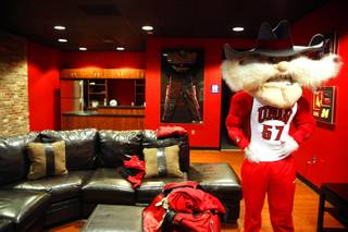 UNLV mascot Hey Reb gets ready to race Weekly reporter Erin Ryan at Pole Position Raceway in Las Vegas on Tuesday, March 6, 2012.