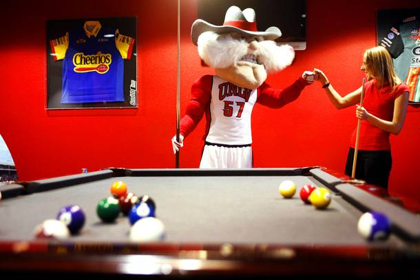 UNLV mascot Hey Reb and Weekly reporter Erin Ryan play some pool at Pole Position Raceway in Las Vegas on Tuesday, March 6, 2012.