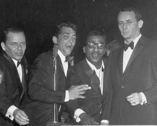 "Members of the Rat Pack, from left, Frank Sinatra, Dean Martin, Sammy Davis Jr. and Joey Bishop, perform at the Sands Hotel in Las Vegas on Jan. 20, 1960. An investigator from the Travel Channel's ""Ghost Adventures"" says there were ""dead guests"" in Sinatra's former suite at the Riviera."