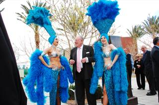 Former Las Vegas Mayor Oscar Goodman, accompanied by his famous showgirls, awaits the unveiling of a bronze bust in his likeness at Symphony Park on Monday, March 12, 2012.