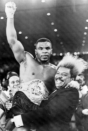 Mike Tyson and Don King after the November 22, 1986 fight with Trevor Berbick that made Tyson the youngest-ever heavyweight champion.