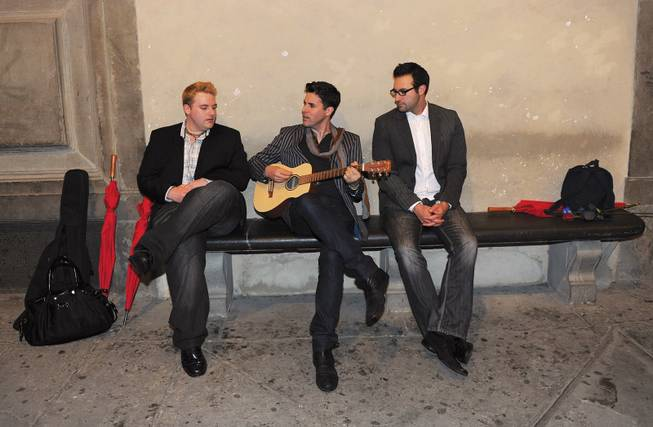 "Stratosphere headliner Frankie Moreno, center, and his brothers Tony, right and Ricky work out the song I Think About You"" near the Duomo in Florence."