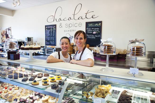 Owner Megan Romano (right) and assistant Keris Kuwana show off the pastries of the day.