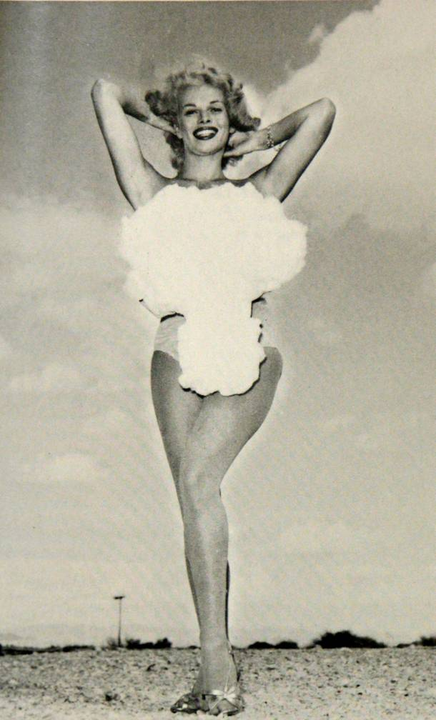 Copa Room showgirl Lee Merlin poses in a cotton mushroom cloud swimsuit as she is crowned Miss Atomic Bomb in this 1957 photograph. Above-ground nuclear testing was a major public attraction during the late 1950s, and hotels capitalized on the craze by hosting nuclear bomb watch parties, which usually included the dubbing of a chorus girl as Miss Atomic Bomb. Merlin was the last and most famous of the Miss Atomic Bomb girls.