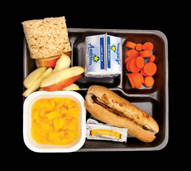 This is a real school lunch. Served to kids at Matt Kelly Elementary School in North Las Vegas. Under the USDA's new nutrition standards, going into affect for the coming school year, the whole wheat bun on the chili cheese dog and the two servings of fruit get to stay. The marshmallow square? Only two grain-based desserts will be allowed per week.