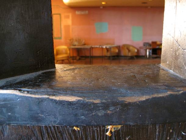 A ledge worn down from patrons leaning their elbows on it over the decades.