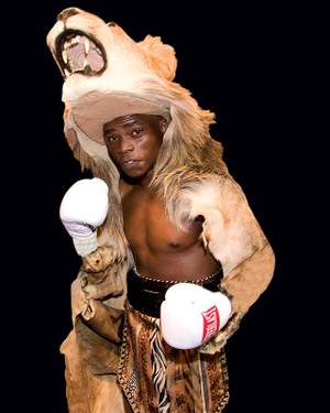 Bogere in the lion headdress he wears to the ring.