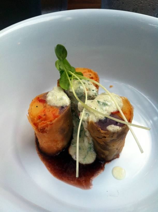 East meets West in purple potato spring rolls with red wine reduction sauce.
