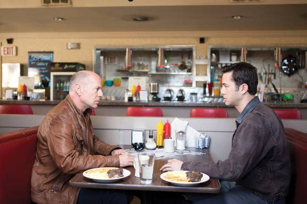 Bruce Willis and Joseph Gordon-Levitt are far more interested in talking than in their steak and eggs in the very clever Looper.