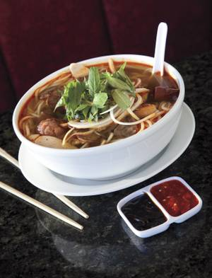 Pho Bosa's <em>bun bo hue</em> will change your life, if you're man enough for a volcanic beef noodle soup with cubes of ginger-infused pork blood.