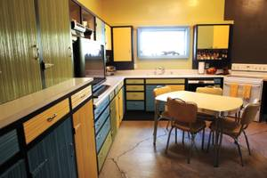 The kitchen space of one of the mid-mod homes seen during the tour.