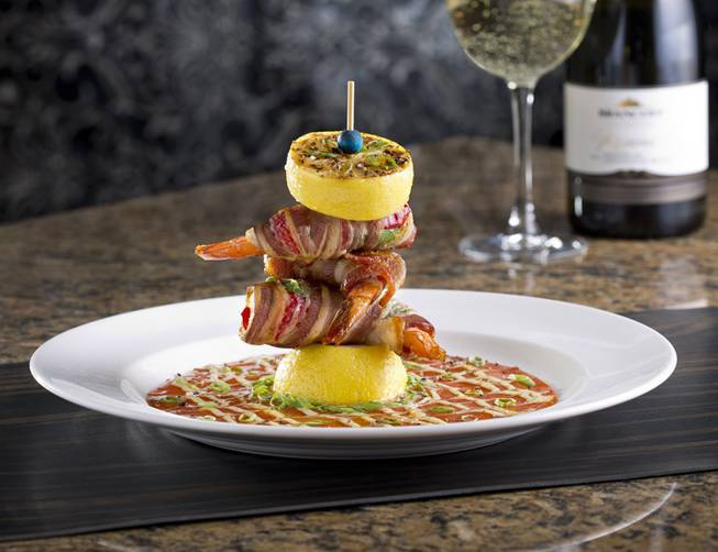 Appetizer insanity: applewood bacon and jalapeno wrapped prawns with guava barbecue sauce and roasted lemon.