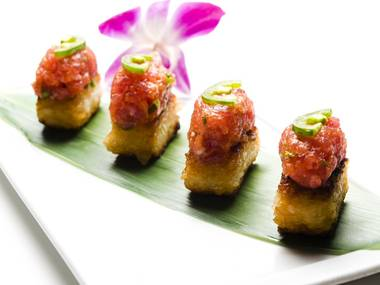 Koi's crispy rice is addictive all by itself, but it comes topped with Kobe beef, yellowtail tartare, or here, spicy tuna.
