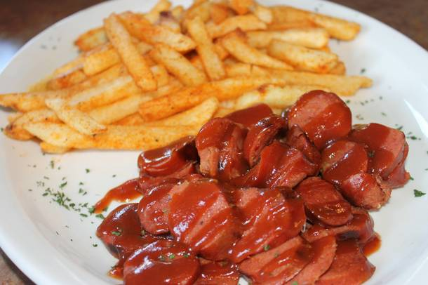 A plate of hot links and fries at Top Notch Barbeque.