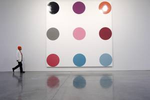 Damien Hirst at <em>The Complete Spot Paintings 1986-2011</em> at Gagosian Gallery in New York.