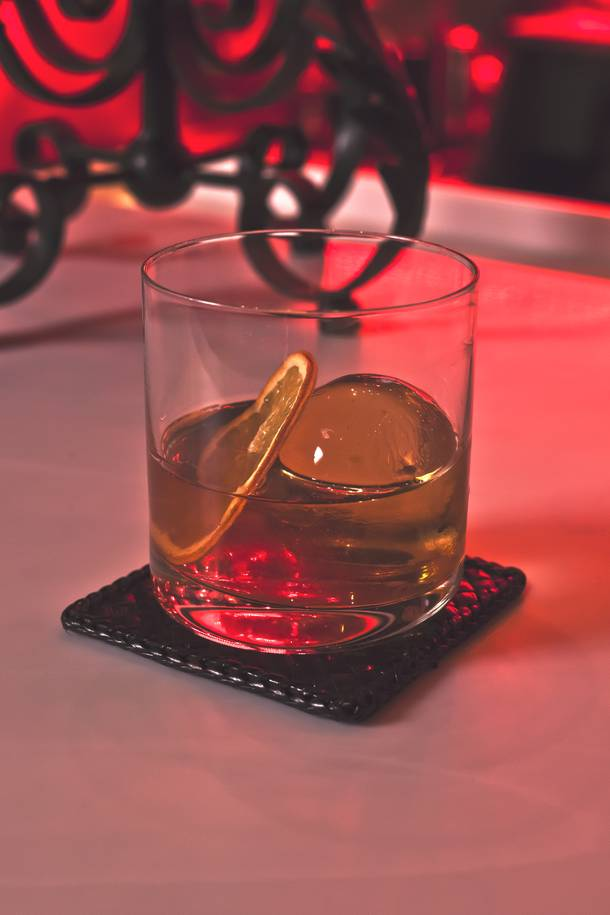 The Rock 'N Rye uses Bulleit Rye, rock candy, roasted pecans and dehydrated orange, wisely served over spherical ice.