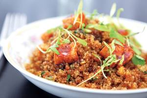 Poppy Den's quinoa fried rice is topped with sun-dried pineapple.