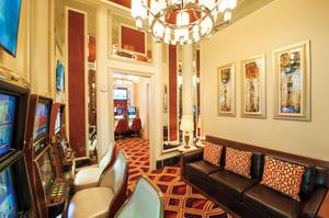 The parlor also includes amenities for players' friends, including sofas and televisions.
