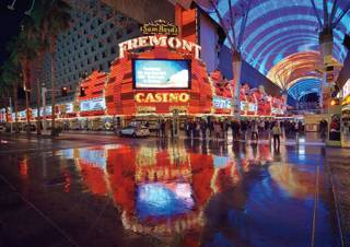 Bill Hughes documents a wet night on the Fremont Street Experience full of rock and straight-faced art.