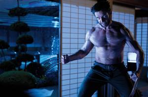 Hugh Jackman gets out his claws in <em>The Wolverine</em>.