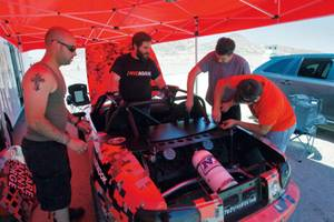 George, Danny, Kyle and Julian get the Miata ready for runs at Willow Springs. Little did they know they would have issues with the cooling system, exhaust and transmission that day. As Kyle says, it's better to have sh*t break during practice.