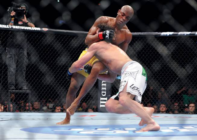 Anderson Silva, left, seen here fighting Chael Sonnen in 2012, defends his middleweight title against Chris Weidman this weekend.
