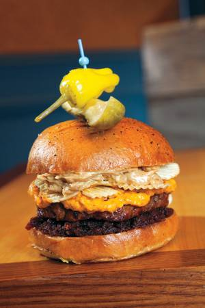 Pub 1842's Peanut Butter Crunch Burger contains peanut butter, pimento cheese, bacon jam and potato chips.