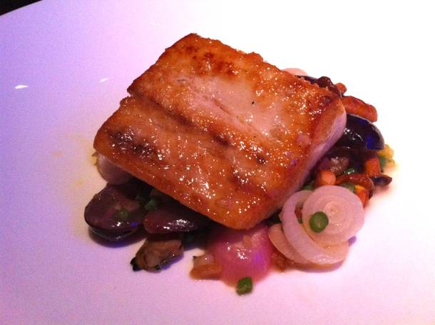 Pacific yellowtail kampachi with chanterelle mushrooms, bacon, Manila clams and black grapes.