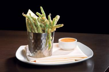 Fun, different bar snacks are on the menu at Heraea, including these crispy green beans with chili aioli.