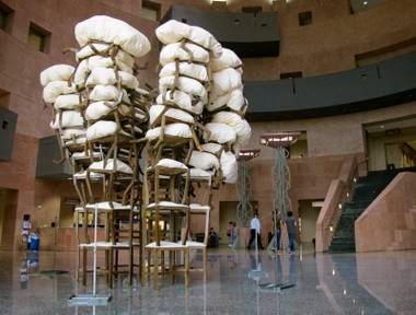 A 16-foot tower made of more than 50 stacked chairs.