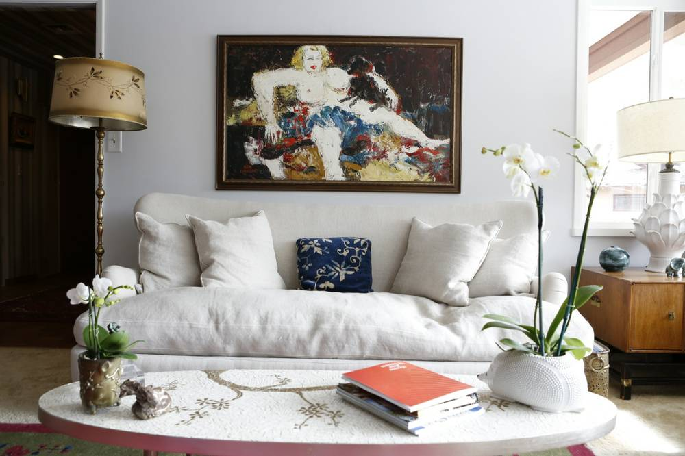 A Sam Diamond Painting Hangs Above A Sofa In The Living Room Of Kate  Aldrich And Tim Shaffer, Owners Of Patina Decor, In Downtown Las Vegas.