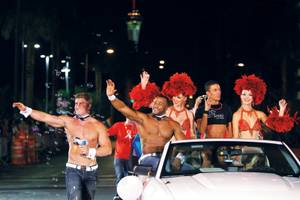 Many local organizations join in on the Pride parade fun, including the casts of Chippendales and <em>Divas</em>.