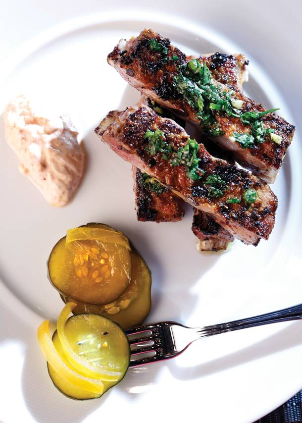 Vadouvan grilled lamb ribs with bread and butter pickles.
