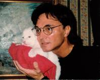 Roy Horn with a white tiger cub. October 3 marks the tenth anniversary of the incident where Roy was dragged offstage by white tiger Montecore during a performance of <em>Siegfried & Roy</em> at the Mirage.
