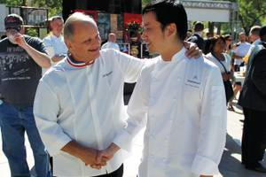 Chefs Joël Robuchon and Ho Chee Boon seemed to have no problem sampling eight mini-burgers.