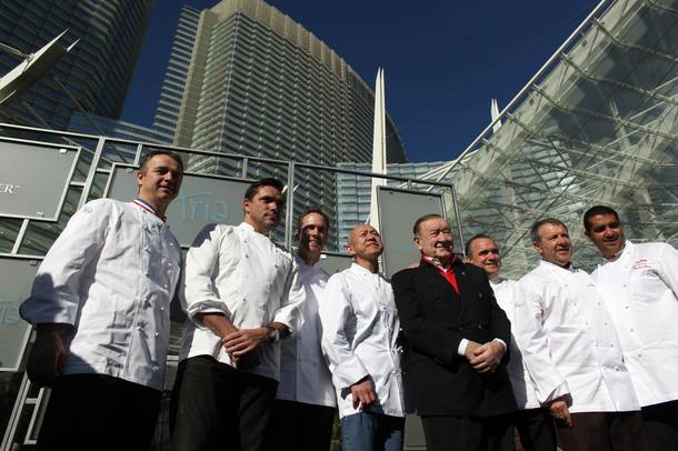 From left, Jean-Philippe Maury, Todd English, Shawn McClain, Masa Takayama, Sirio Maccioni, Jean-Georges Vongerichten, Julian Serrano and Michael Mina pose at the late 2009 opening of Aria. Except for McClain and Takayama, all of these chefs and restaurateurs also helped open Bellagio in 1998.
