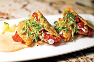 One way to enjoy Hawaiian-style poke at Zenshin is in these tasty little tacos.