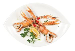 Milos' langoustines are sourced from Scotland and made with hand-shoveled salt from Kythira island in Greece as well as organic lemons and parsley from California.