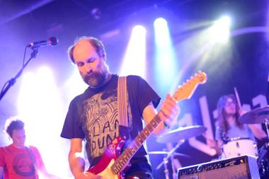 Longtime Built to Spill leader Doug Martsch, center, performs alongside new bassist Jason Albertini, left, and drummer Steve Gere Tuesday night at Vinyl.