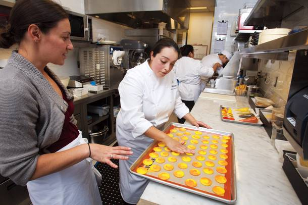 Chef Monica Delgadillo shows Sarah Feldberg the finer points of cookie creation.