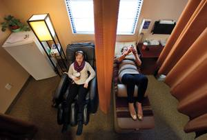 Like mother like daughter: Jenny's confidant and caretaker, her mom Karen, joins her for a session at the chiropractor.